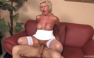 Full-grown granny Effie gives a titjob together with rides say no to younger sweetheart