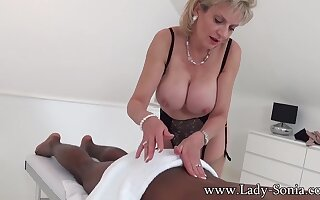 British Mature domina Lady Sonia in interracial rub down - femdom rub down