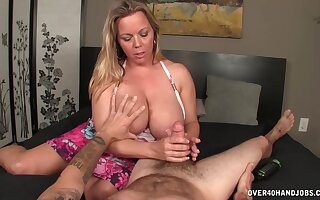 Chubby mature shakes her monster tits while surprising her stepson respecting hot handjob