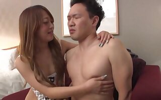 Fit Japanese girl gives a blowjob increased by gets fucked hard on the floor