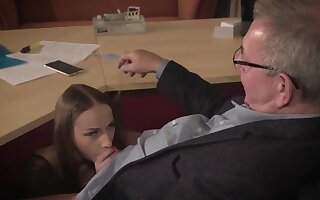 Staggering brunette with glasses is having a ffm triune at work with an increment of enjoying it a lot